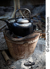 old used kettle on tradition stove with water stream for...