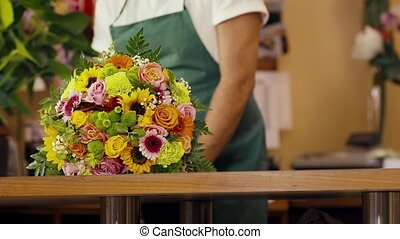 happy man working as florist - mid adult man working as...