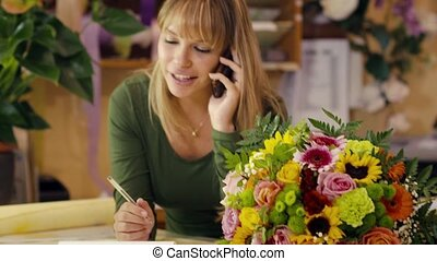 florist talking on telephone - portrait of young hispanic...