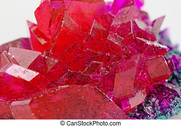 close up of crystals in ruby color on white background red...