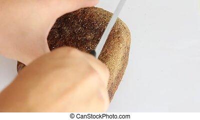 sliced dark bread pieces, on white