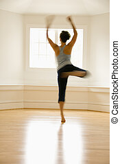 Dancing woman in motion - Young woman in motion jumping and...