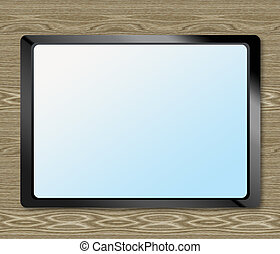 Tablet on the table wooden