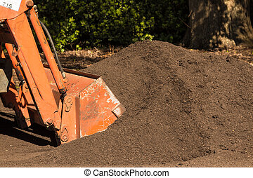 Topsoil - front end loader scooping up some rich garden...