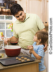 Father and son. - Hispanic father and son in kitchen making...