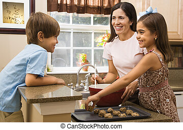 Family making cookies. - Hispanic mother and children in...
