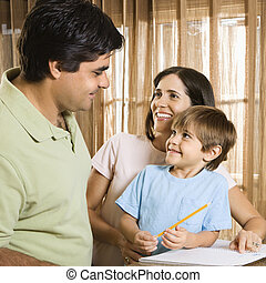Happy family. - Hispanic parents making eye contact with son...