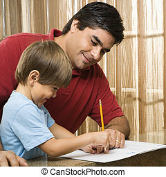Dad helping son. - Hispanic father helping son with...