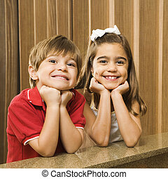 Hispanic sibling portrait - Hispanic children with their...