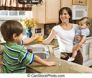 Mom and children in kitchen. - Hispanic mother and children...