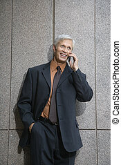 Man on cell phone. - Caucasian middle aged businessman on...
