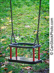 Swing - Empty swing with green blurry background Concept and...