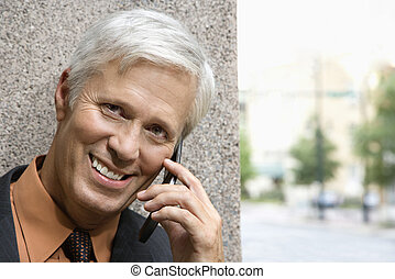 Man on phone. - Caucasian middle aged businessman talking on...