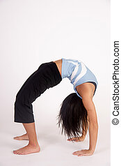 Beautiful Young Brunette Woman Practicing Yoga Meditation...