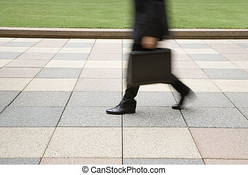 Businessman walking - Motion blur of businessman legs...