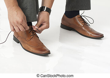 tying shoelaces in the office