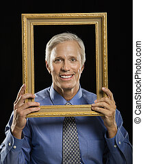 Man in picture frame.