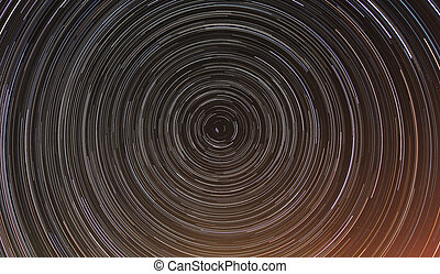 Cumulative time lapse of star trails in night sky
