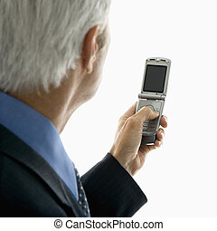 Man text messaging - Back view of Caucasian middle aged man...