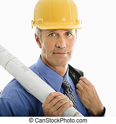 Businessman in hard hat - Caucasian middle aged businessman...