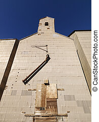 Grain elevator - Low angle of abandoned metal grain elevator...