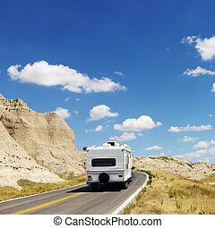 Camper on scenic road. - Recreational vehicle on scenic road...