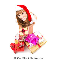 Portrait of young, sexy woman Santa with gift boxes