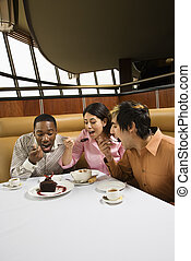 Friends eating dessert. - Small group of mid adult friends...