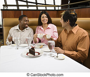 Friends eating. - Small group of mid adult friends at...