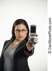 Woman using camera phone - Caucasian mid adult professional...