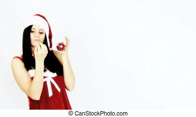 Female santa holding christmas ball - Happy sexy female...