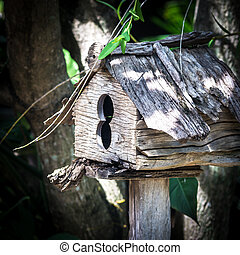 Wooden birdhouse in the park