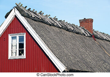 Thatched roof - Red peasant house with thatched roof