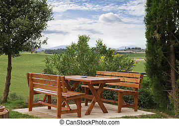 Picnic table - Wood picnic table and benches in countryside