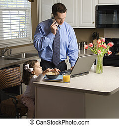 Father with daughter - Caucasian father in suit talking on...