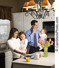Family in kitchen. - Caucasian mother and father in kitchen...