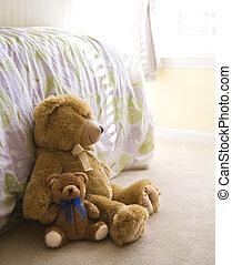 Teddy bears. - Plush brown teddy bears on bedroom floor.