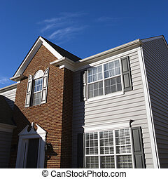 House exterior. - Exterior of brick and vinyl siding house.