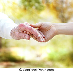 Holding hands with senior on autumn yellow foliage...