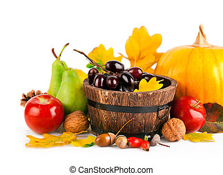 autumnal harvest fruits and vegetables with yellow leaves...
