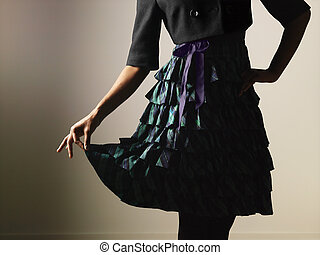 Woman feminine dress - Woman wearing ruffled dress holding...