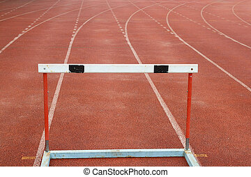 a hurdles on red running tracks