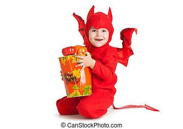 little boy in red devil costume sitting near big bucket -...