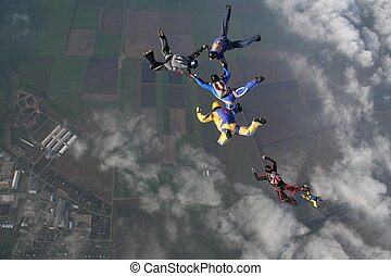skydiving group - The group of parachutists in air