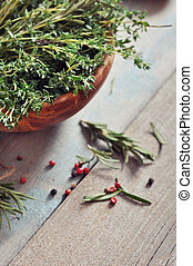 Condiment - Rosemary and thyme in granite mortar with pepper...