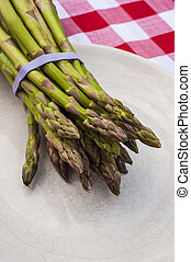 Asparagus plate on red tablecloth - Asparagus and plate on...