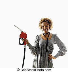 Smiling woman with petro hose - Woman holding gasoline pump...
