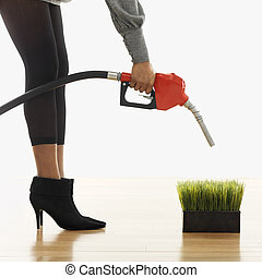 Environmentally friendly fuel concept - Woman holding...