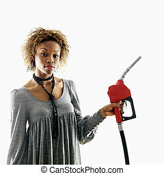 Woman holding gas nozzle - Portrait of pretty young woman...