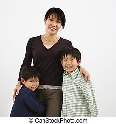 Mother and children - Portrait of Asian mother with two...